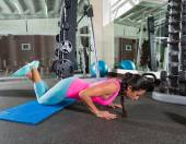 Brunette woman at gym knees push up push-up — Stock Photo