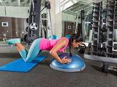Bosu knees push up push-up woman at gym — Stock Photo