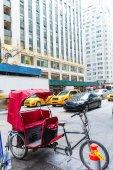 Avenue of Americas 6th Av new york rickshaw — Stock Photo