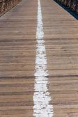 Brooklyn bridge wooden soil pavement detail NY — Stock Photo