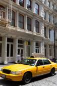 New York Soho buildings yellow cab taxi NYC USA — Stock Photo
