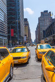 Times Square New York yellow cab daylight — Стоковое фото