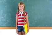 Blond braid schoolgirl with student spiral notebook — Stock Photo