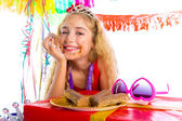 Happy party girl with presents eating chocolate — Stock Photo