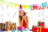 Party blond kid girl happy with puppy present — Stock Photo