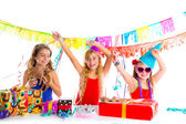 Girl friends party dancing with puppy dog present — Stock Photo