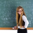 Nerd pupil blond girl in green board schoolgirl — Stock Photo #63246463