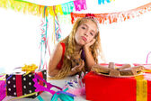Bored gesture blond kid girl in party with puppy — Stock Photo