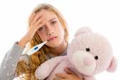 Blond girl with thermometer and flu cold in pyjama — Stock Photo