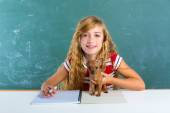 Blond student girl with puppy dog at class board — Stockfoto