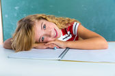 Happy student expression schoolgirl in classroom — Stock Photo