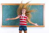 Funny student girl flipping long hair at school — Stock Photo