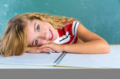 Happy student expression schoolgirl in classroom — Stockfoto