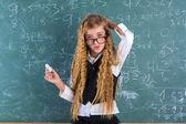 Nerd pupil blond girl in green board schoolgirl — Zdjęcie stockowe