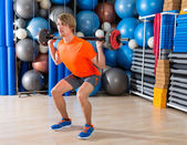 Barbell squats blond man at gym exercise — Stock Photo