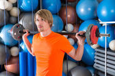 Barbell squats blond man at gym exercise — Stok fotoğraf