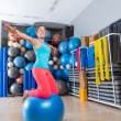 Girl at gym swiss ball knee balance drill exercise — Stock Photo #63929877