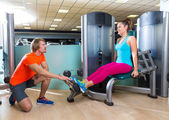 Calf extension woman at gym exercise machine — Stock Photo