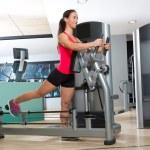 Gym glute exercise machine woman workout — Stock Photo #63930057