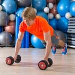 Blond man gym push-up pushup dumbbells — Stock Photo #63934027