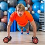 Blond man gym push-up pushup dumbbells — Stock Photo #63934235