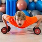 Blond man gym push-up pushup dumbbells — Stock Photo #63934243