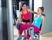 Hip abduction women exercise at gym indoor — Stock Photo