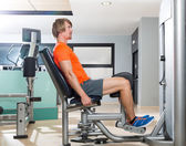 Hip abduction blond man exercise at gym closing — Stock Photo