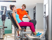 Hip abduction woman exercise at gym closing — Stock Photo