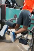 Kneeling leg femoral curl man at gym — Stock Photo