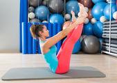 Pilates Open Leg Rocker exercise on mat woman — Stock Photo