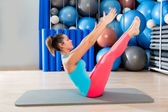 Pilates Teaser exercise woman on mat gym indoor — Stock Photo