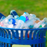 Trash bin full of beverage empty bottles — Stock Photo #65886965
