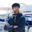 Sailor in marina port with boats background — Stock Photo #68521547