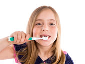 Blond kid indented girl cleaning teeth toothbrush — Stock Photo