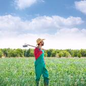 Farmer man with hoe looking at his field — Foto Stock