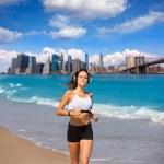 Brunette girl running in New York Brooklyn bridge — Stock Photo #70622343