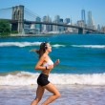 Brunette girl running in New York Brooklyn bridge — Stock Photo #70622411