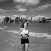 Brunette girl running in New York Brooklyn bridge — Stock Photo