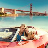 Selfie of young couple convertible car Golden Gate — Stock Photo
