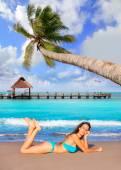 Brunette tourist lying in beach sand tanning happy — ストック写真