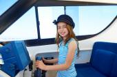 Kid girl pretending be a captain sailor cap in boat — Stock Photo