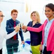 Happy business team toasting with champagne — Stock Photo #75548497