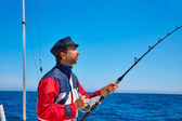 Beard sailor man fishing rod trolling in saltwater — Stock Photo