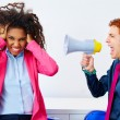 Businessman shouting megaphone to african woman — Stock Photo #75553017