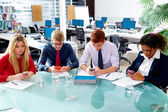 Business people team playing smartphones — Stock Photo