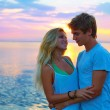 Blond young couple hug in sunset sea lake happy — Stock Photo #75578643