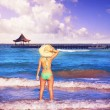 Girl young standing looking at the sea beach hat — Stock Photo #75580851