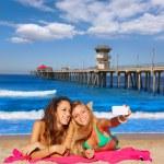 Happy girl friends selfie portrait beach sand — Stock Photo #75581831