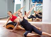Pregnant woman pilates side stretchs exercise — Stock Photo